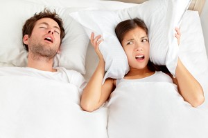 Man snoring in bed due to sleep apnea